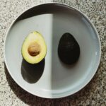 parts of healthy avocado on plate